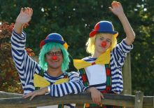 two clowns waving
